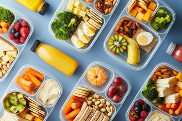 Flat Lay of lunches neatly organized in portion control tupperware containers