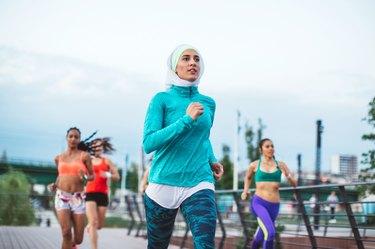 Women in running group training for an 8K run