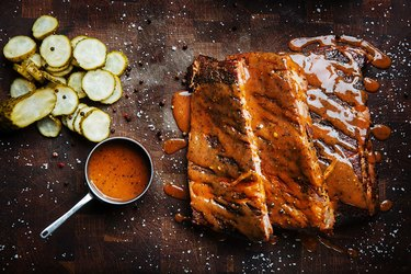 Cook barbecue ribs in an oven and on a grill