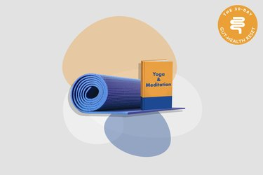yoga mat with orange yoga and meditation book on gray background with colorful shapes