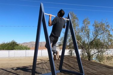 man doing pull-up using homemade outdoor pull-up bar