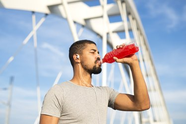 man drinking energy drink