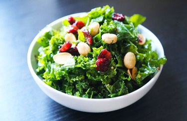 Kale salad with dried fruit and almonds