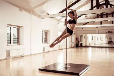 Women trying a pole dancing class for exercise