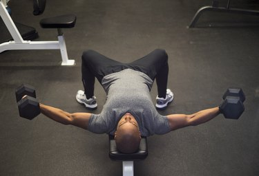 Man performing dumbbell fly