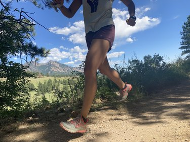 photo of lower half of woman running on an outdoor trail