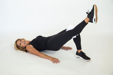Denise Austin performing bottoms up exercise.