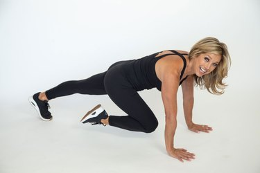 Denise Austin performing back strengthener exercise.