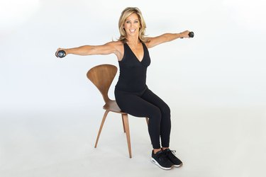Denise Austin performing upper back firmer exercise.