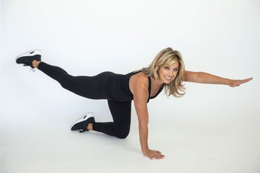 Denise Austin performing exercise in studio setting.