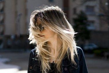 Blonde woman hair blowing