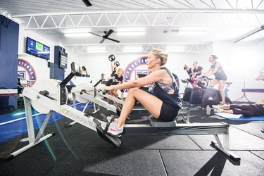 woman on a rowing machine during an F45 Training Class