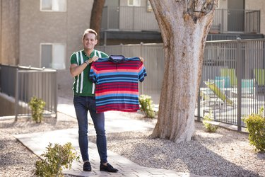 Pierre holds one of his old shirts