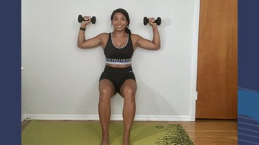Move 5: Wall Sit With Shoulder Press