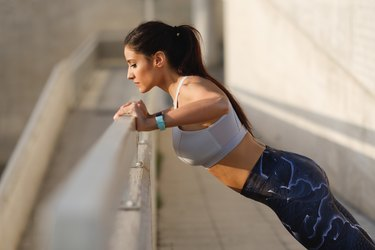 Woman doing wall push-ups