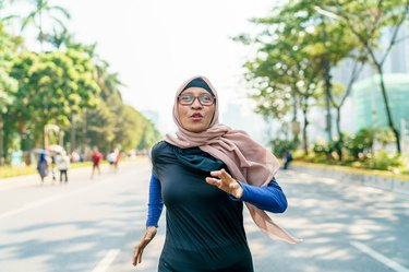 Woman doing a running workout outside