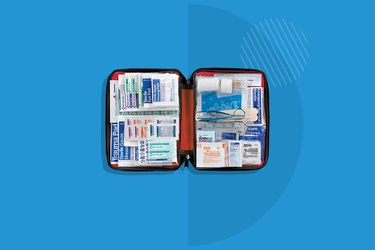 open Red Cross Deluxe All-Purpose First Aid Kit on blue background