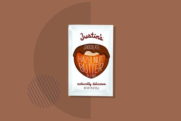 Justin's Chocolate Hazelnut and Almond Butter Squeeze Pack on brown background