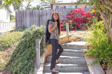 Kristina poses on outdoor steps