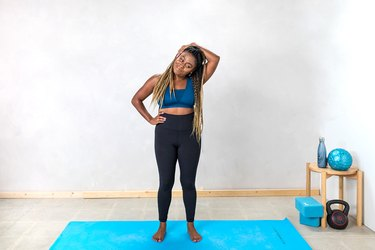 woman doing a lateral neck stretch