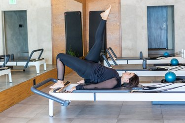 woman doing Pilates to help with running