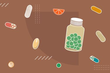 Colorful variety of vitamin and supplement pills on a brown background