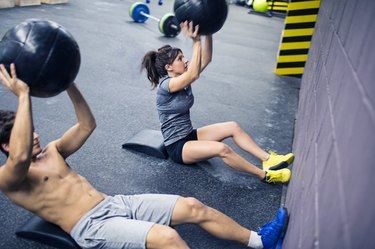 People doing a beginner CrossFit workout