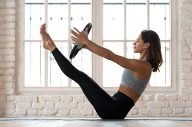 Woman doing Pilates workout at home