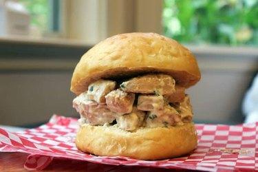 Chicken salad sandwich on a sandwich bun.