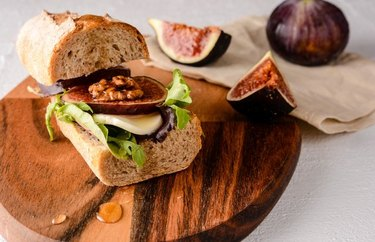Whole wheat baguette filled with cheese, chicken, figs and greens.