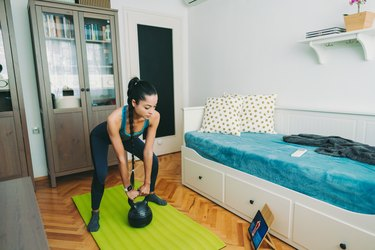 woman using kettlebell for home workout