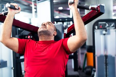 man in gym doing bicep exercises