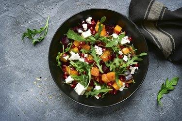 Pumpkin salad with beetroot, arugula and feta cheese