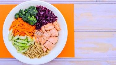 Fresh Healthy Salmon Poke Bowl With Broccoli, Carrots, Wholegrain Rice
