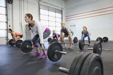 gym class practicing deadlifts