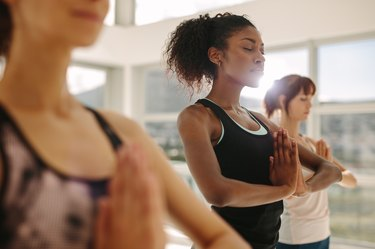 A group of women practicing yoga at the gym