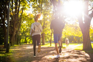 Couple exercising in park.