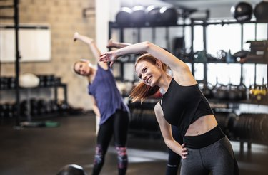 Group of People Exercising at a Gym
