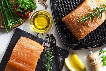Raw salmon steak and herbs