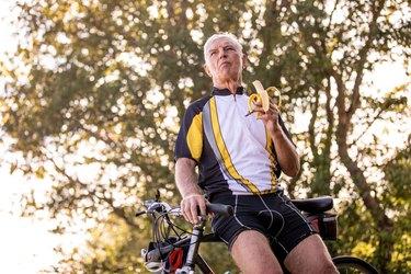 Senior Cross-country Cyclist Eating a Banana