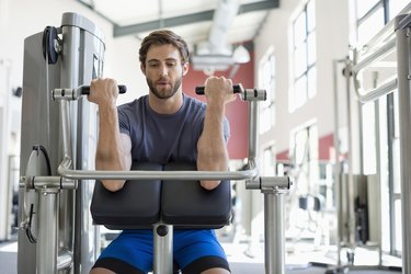 Active young man exercising in a gym