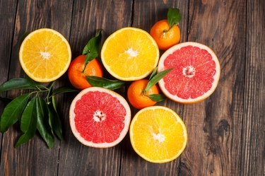 Citrus fruits on a wooden table background