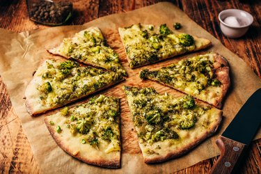 Cruciferous vegetables slices of pizza with broccoli and cheese