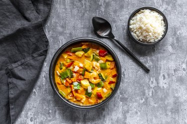 Curry dish, sweet potato curry, sugar pea, paprika, zucchini, coconut milk, shrimps and rice