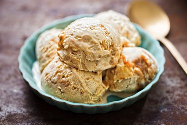 Salted caramel ice creams on blue plate