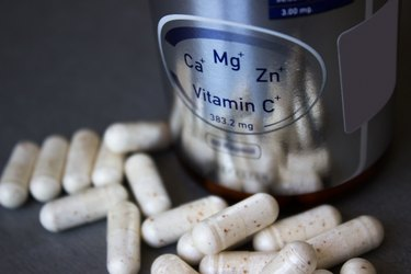 Vitamin bottle with scattered pills