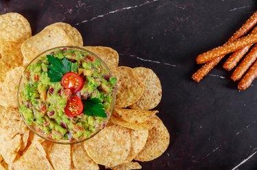 Mexican food nachos guacamole, doritos and tortilla chips