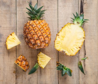 Directly Above Shot Of Pineapples On Cutting Board