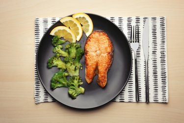 Low-carb roasted salmon steak with broccoli on plate for keto diet