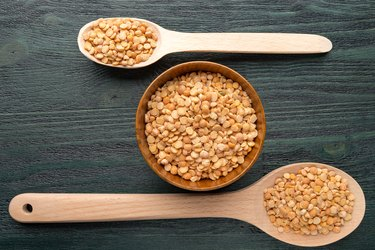 Wooden spoons and bowls with split peas